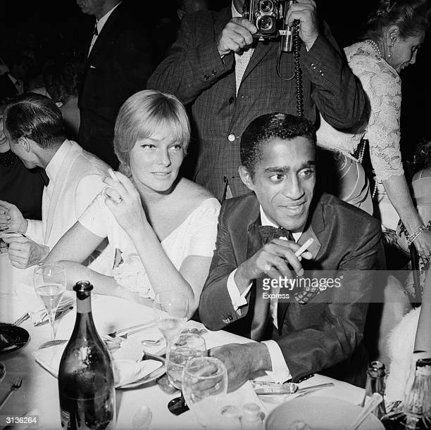 American singer dancer and actor Sammy Davis Junior with his wife the Swedish actress May Britt at the Cocoanut Grove Club Hollywood