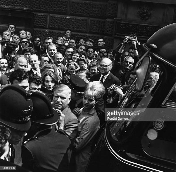 Christine Keeler and Mandy RiceDavies jostled by the crowds and reporters as they leave the Old Bailey during the trial of Dr Stephen Ward a major...