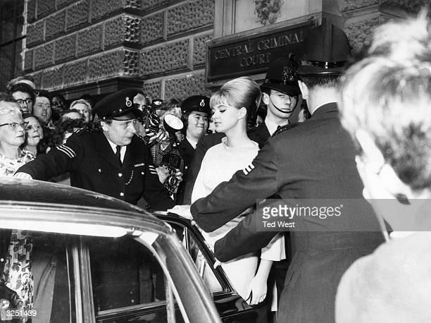 Mandy Rice Davies the model and show girl leaves the court after the first day of Dr Stephen Ward's vice trial at the Old Bailey