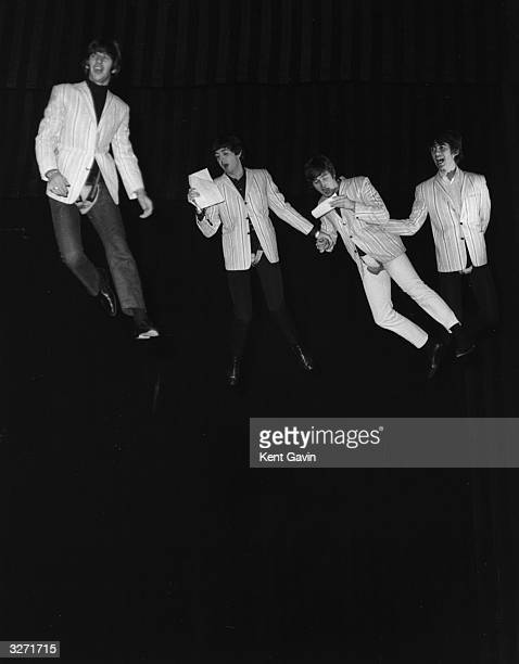 The Beatles suspended on wires during a rehearsal of their flying scene for the 'Night Of 100 Stars' charity show at the London Palladium