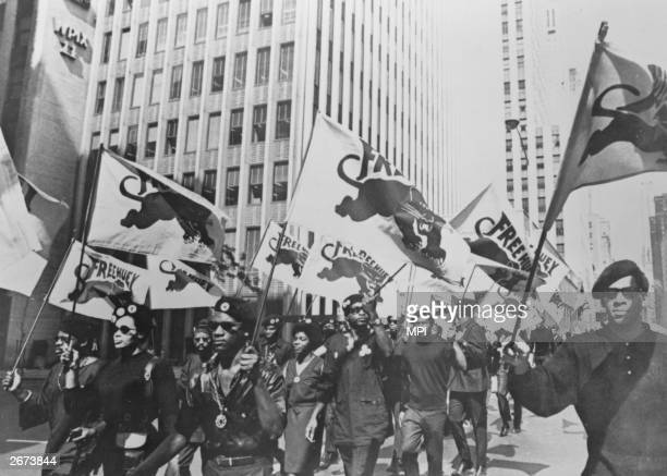 Black Panthers march to a news conference in New York to protest at the trial of one of their members Huey P Newton Newton was later convicted for...