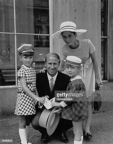 England and Manchester United footballer Bobby Charlton with his wife Norma and his daughters Suzanne and Andrea after receiving his OBE at...