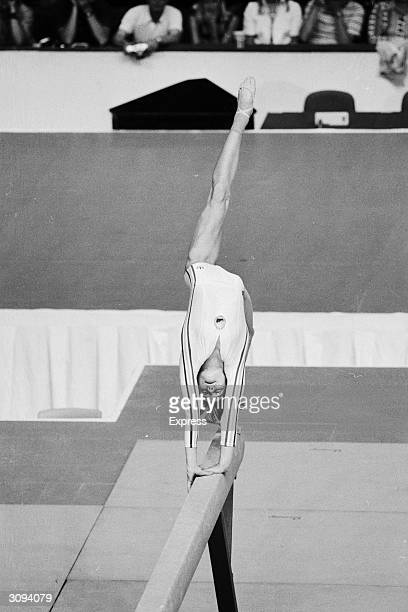 Romanian gymnast Nadia Comaneci during her medal winning performance on the beam in the Montreal Olympics