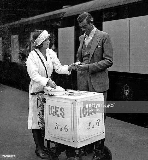 22nd July Gary Cooper the American film actor buys an ice cream at Waterloo Station London before his departure home