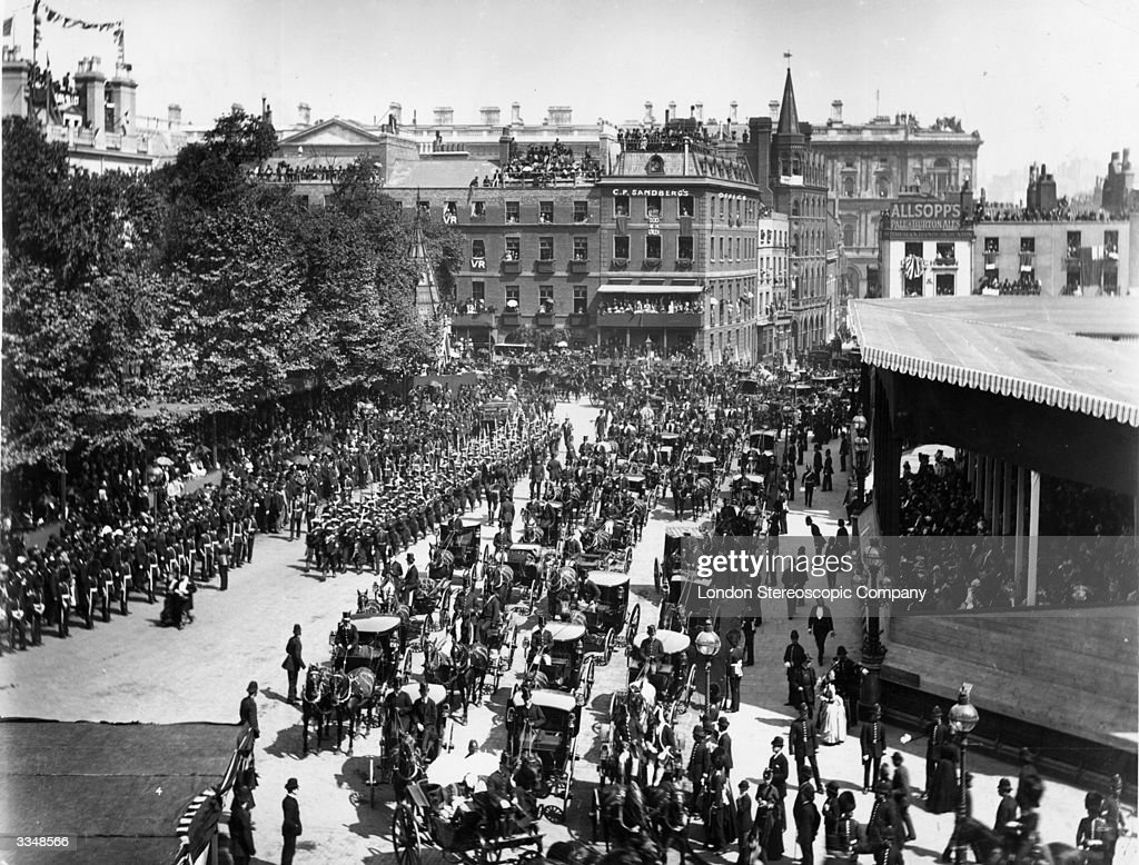 A parade of carriages making its way through London towards Westminster Abbey, to celebrate Queen Victoria's Golden Jubilee.