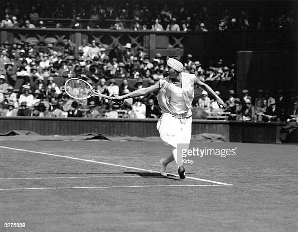 French tennis player Suzanne Lenglen in action during the tennis championships at Wimbledon.