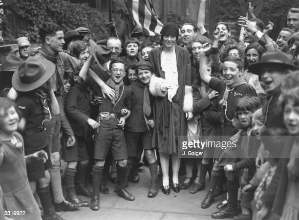 American aviatrix Amelia Earhart being cheered by the children in the East End during her visit to Toynbee Hall London