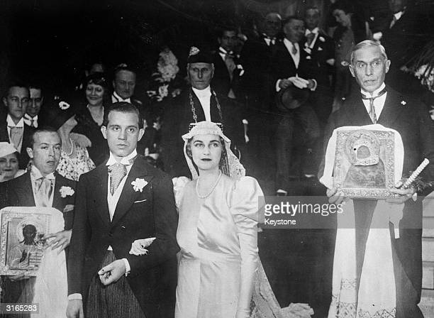 Prince Alexis Mdivani and American socialite and Woolworth heiress Barbara Hutton leaving the Russian Orthodox Church in paris after their wedding