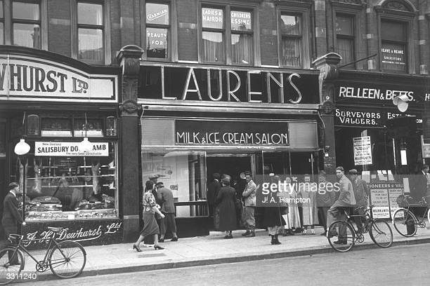 Shoppers walking past the Laurens Hall of Mirrors Milk and Ice Cream salon in Finchley Road London