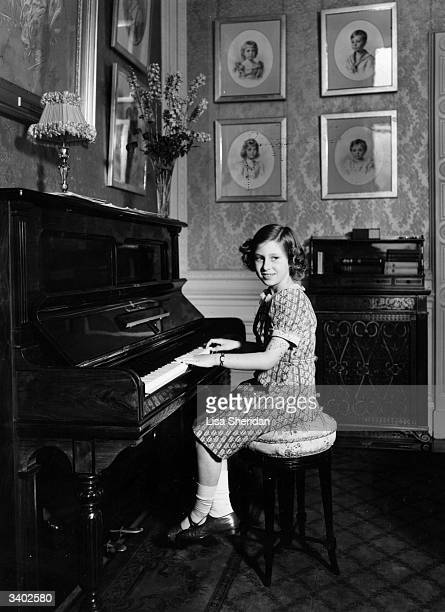 Princess Margaret Rose younger daughter of King George VI and Queen Elizabeth playing the piano at Royal Lodge Windsor