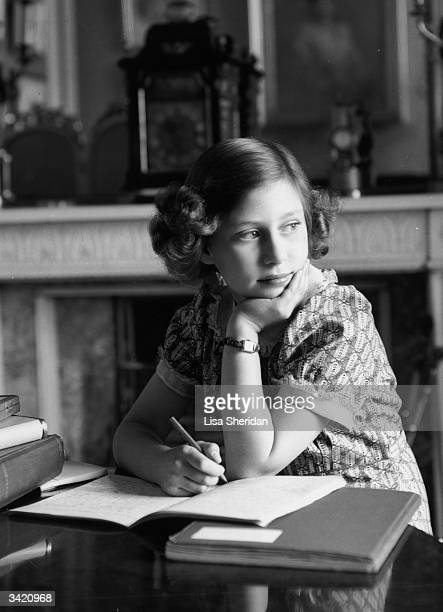 Princess Margaret Rose younger daughter of King George VI and Queen Elizabeth in the schoolroom at Windsor Castle