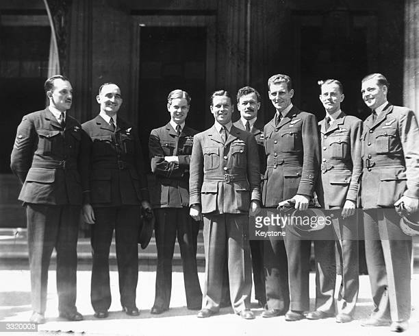 Wing Commander Guy Gibson after his investiture with the Victoria Cross at Buckingham Palace together with the Australian airmen who took part in the...