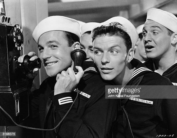 Frank Sinatra as Clarence Doolittle in MGM's 'Anchors Aweigh' directed by George Sidney He and the other sailors eavesdrop on shipmate Gene Kelly as...