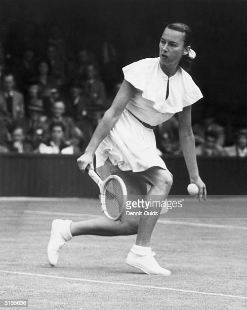 American tennis player Gertrude 'Gussie' Moran on court during the Wimbledon Lawn Tennis Championships