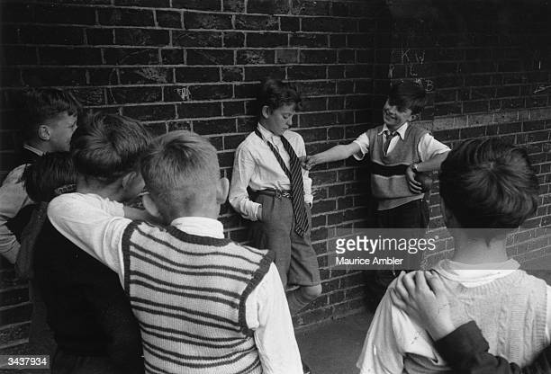 Children bullying a boy in a playground Original Publication Picture Post 8798 Doctor With A Camera unpub
