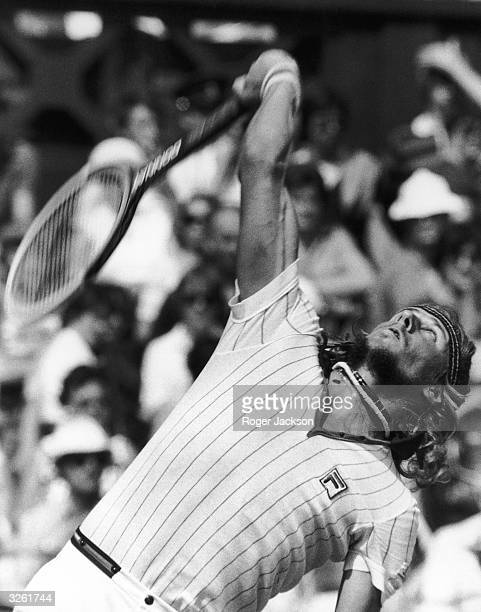 Swedish tennis player Bjorn Borg serves against Marty Riessen of the United States on Centre Court at the Wimbledon Tennis Championships,