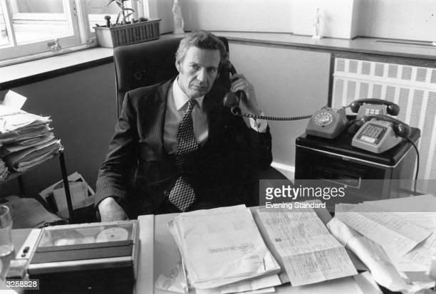 An executive at work makes a phone call