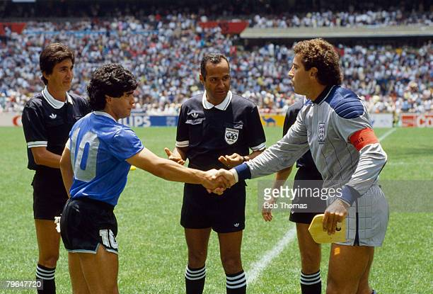 22nd June 1986 1986 World Cup Finals Quarter Final in Mexico City England captain Peter Shilton shakes hands with Argentina captain Diego Maradona...