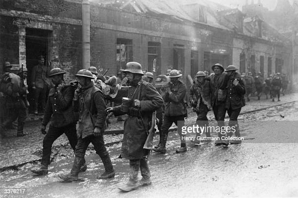 Wounded British and German troops in the streets of St Quentin France after the Second Battle of the Somme