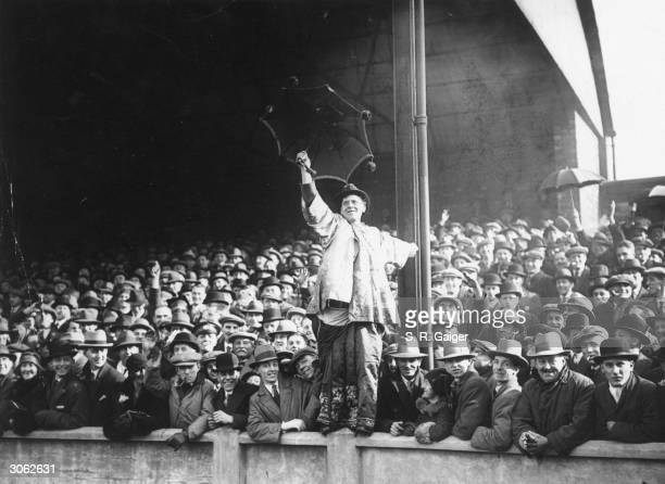 A Hull supporter the crowd before the start of an English semifinal CupTie at Leeds between Arsenal and Hull City