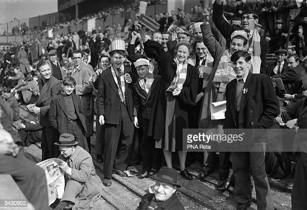 Arsenal supporters outside the White Hart Lane football ground in Tottenham London for the replay of the FA Cup semifinal between Chelsea and Arsenal