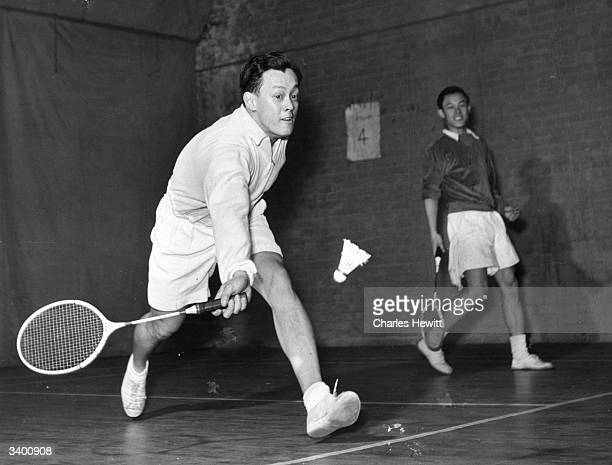 Eddie Choong All England singles badminton champion playing with a friend Original Publication Picture Post 5703 Champion Choongs pub 1952