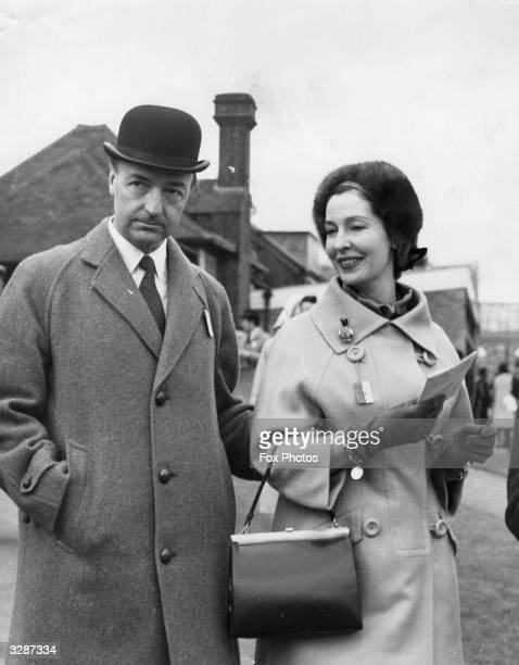 John Profumo Secretary of State for War and his wife the former actress Valerie Hobson at Sandown Park