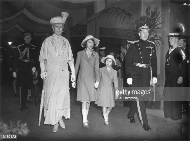 Queen Mary and her two granddaughters Princess Elizabeth and Princess Margaret attending an afternoon performance at the Royal Tournament in Olympia