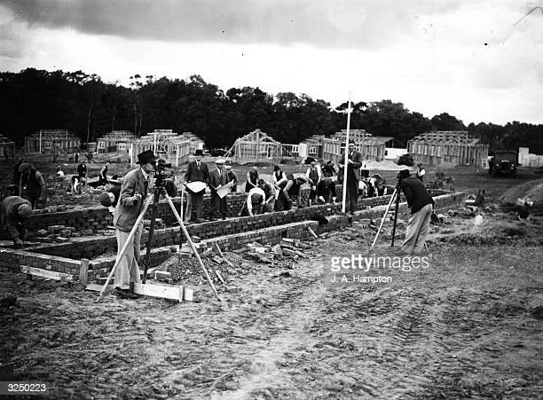 Workmen building a camp which is to hold British conscripts at Crookham near Aldershot on the village football and cricket grounds