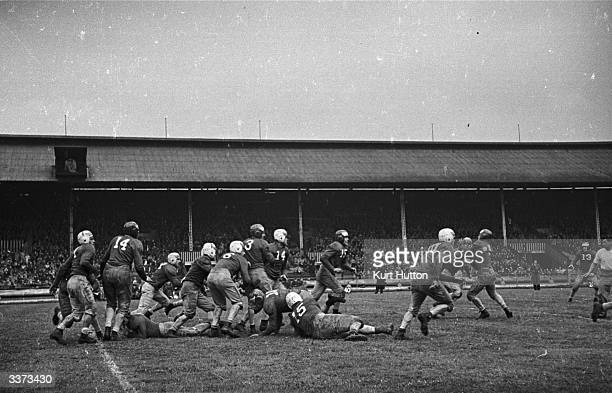 A game of American football at White City stadium London between 'Crimson Tide' and 'Fighting Irish' staged by the US Army for a mixed audience of...