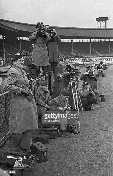 American photographers getting a good picture of a game of American football at White City stadium, London, staged by the US Army for a mixed...