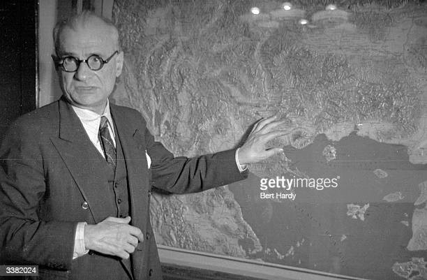 General Stratos , Greek Minister for War consults a map of Greece in his Athens headquarters during the Greek Civil War. The guerrilla forces are...