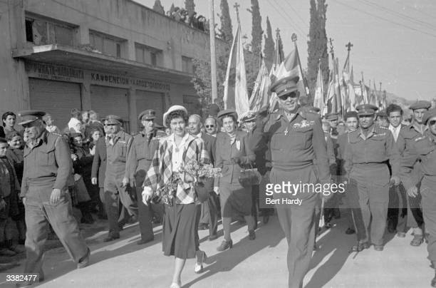 King Paul I and Queen Frederika of Greece arrive in Lamia and join a procession of their troops during the Greek Civil War Original Publication...