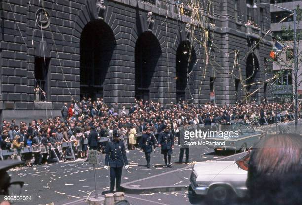 New York City - NYPD Police officers patrol the large crowds along Broadway's 'Canyon Of Heroes,' during a ticker tape parade. The parade was held in...