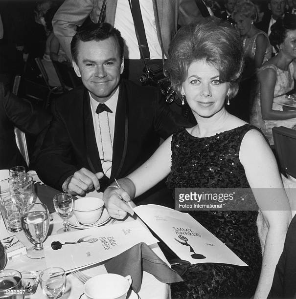 American actor Bob Crane sitting with his wife Anne Terzian at the Emmy Awards Hollywood California Terzian is holding an open Emmy Award program in...