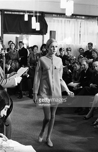 Fashion model Twiggy modelling an item from her own range of clothes.