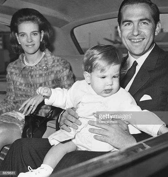 King Constantine II of Greece with his wife Queen AnneMarie and their son Prince Paul on arrival at London's Heathrow Airport