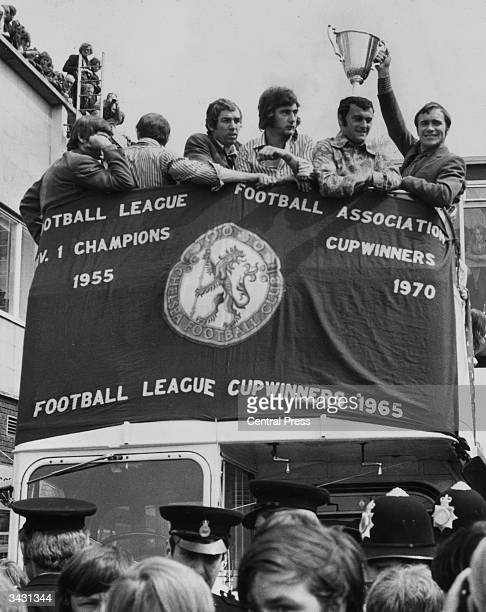 From left to right Chelsea footballers Marvin Hinton Alan Hudson Keith Weller and captain Ron Harris celebrate their victory over Real Madrid in the...