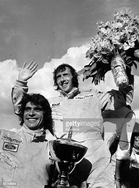 Scottish motor racing driver Jackie Stewart and his Tyrrell teammate Francois Cevert on the victory podium after winning the Belgian Grand Prix...