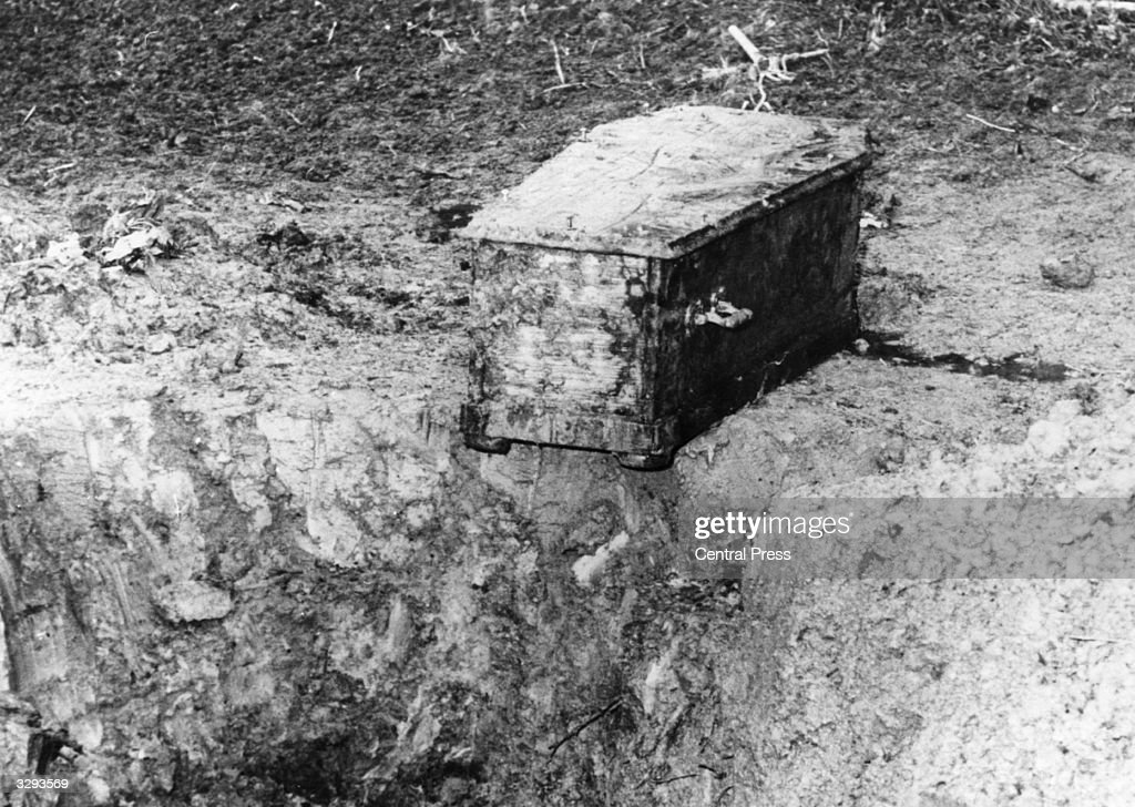 Charlie Chaplin's stolen coffin which was found after eleven weeks following the arrest of two car mechanics in Lausanne. They were charged with attempted extortion and disturbing the dead. The oak coffin was buried in a freshly sown maize field ten miles away from Chaplin's home at Cornier-sur-Vevey