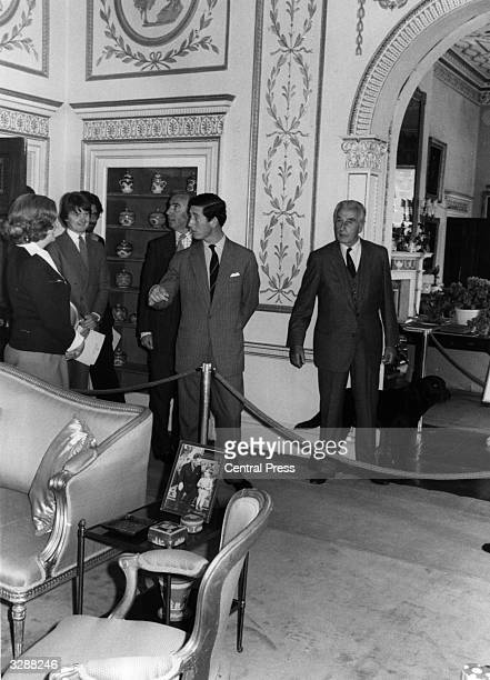 Charles Prince of Wales and Lord Louis Mountbatten showing guests around Mountbatten's country home Broadlands in Romsey Hampshire during a public...