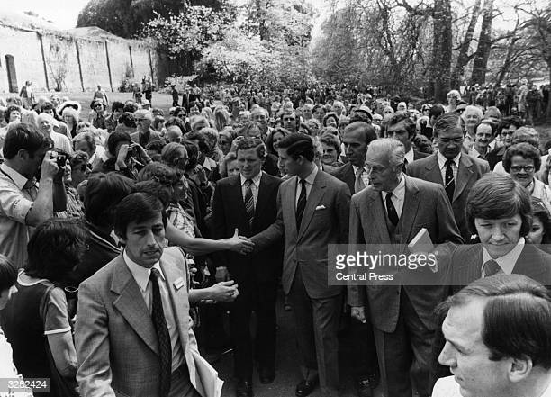 Prince Charles Prince of Wales with Lord Louis Mountbatten in the grounds of Broadlands the Mountbattens' home in Hampshire soon after it was opened...