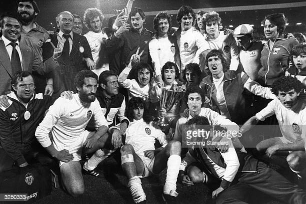 The Jubilant players of Valencia football team celebrate their 54 win on penalties over Arsenal in the European Cup Winners Cup final at Heysel...
