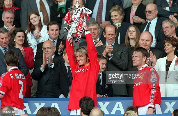 22nd MAY 1999 FA Cup Final Wembley Manchester United 2 v Newcastle United 0 Manchester United's David Beckham takes his turn to hold the FA Cup...