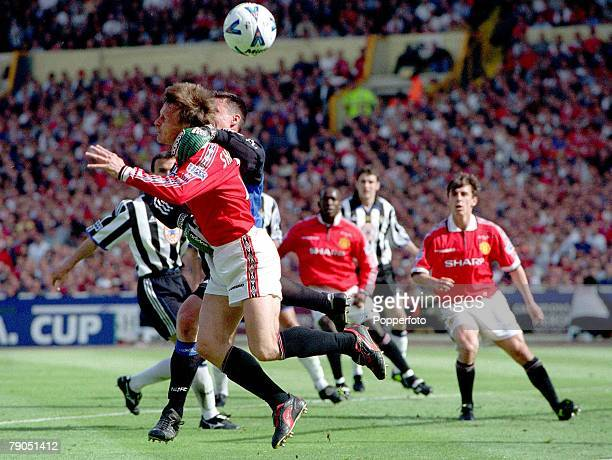 22nd MAY 1999 FA Cup Final Wembley Manchester United 2 v Newcastle 0 Man Utd's Teddy Sheringham tangles with Newcastle's goalkeeper Steve Harper
