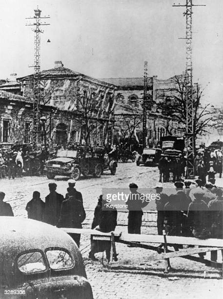 Locals watch as a German column passes through the city of Simferopol the Crimean capital which they had captured on 2 November