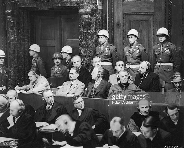 Members of Adolf Hitler's Third Reich sit in the witness box with headsets on on the third day of the International Military Tribunal's war crimes...
