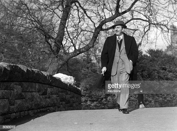 American animator and producer Walt Disney walking through St Stephens Green, Dublin, in the Republic of Ireland.