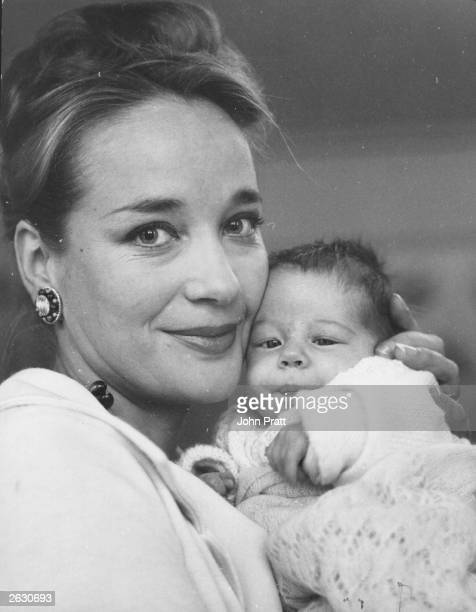 Sylvia Syms the British actress is pictured looking radiantly happy with her new born daughter She and her store executive husband Alan Edney already...