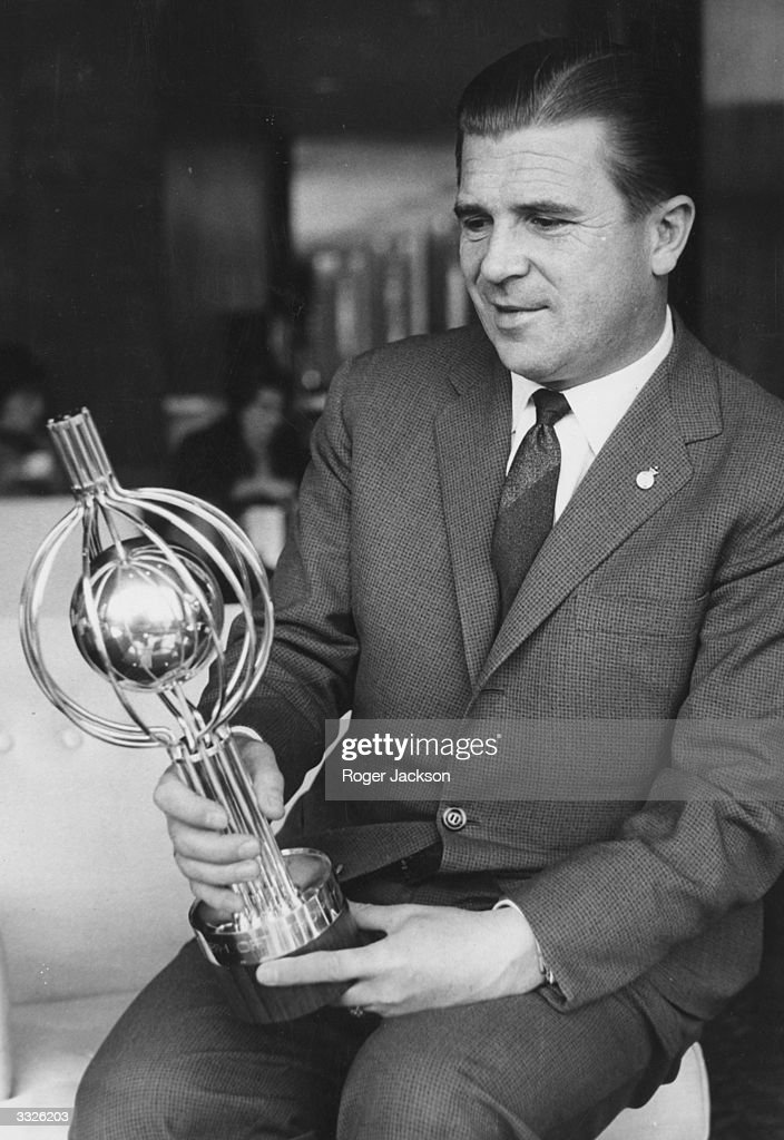 Real Madrid and Hungarian soccer star Ferenc Puskas admires the silver trophy specially made as a prize for the winners of the charity game between Real Madrid and Chelsea at Stamford Bridge.